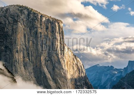El Capitan rock close-up in Yosemite National Park Valley at cloudy autumn morning from Tunnel View. Low clouds lay in the valley. California, USA.