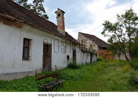 Courtyard of the church. Ungra is a commune in Bra?ov County, Romania. In Ungra there is a medieval 13th century Transylvanian Saxon church and many old houses poster