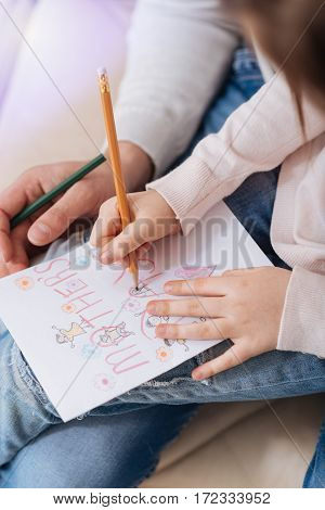 Beautiful postcard. Close up of a handmade postcard being drawn by a pretty pleasant positive girl while preparing to Mothers Day