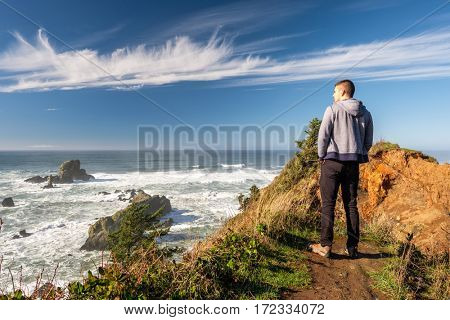 Lone man at USA Pacific coast landscape, Oregon State
