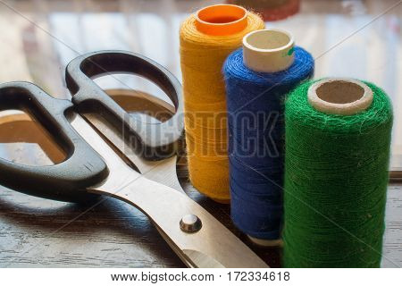 Sewing Threads and Scissors. Sewing Kit Macro View.