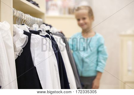 Hanger with shirts in a store. Children's clothing