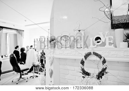 Decorative Wreath, Clock And Love Words On Decor At Beauty Salon. Black And White Photo