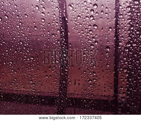 Water and rain drops on the glass, abstract view, Drops of rain on blue glass background / drops on glass after rain