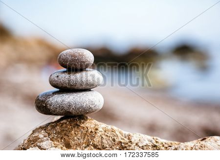 Stones balance, pebbles stack over blue sea. Picturesque and gorgeous scene. Location place Crimea, Ukraine, Europe. Beauty world. Discover the world of beauty.