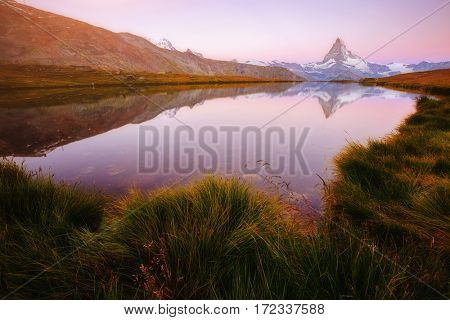 Great view of the famous peak Matterhorn in alpine valley. Popular tourist attraction. Dramatic and picturesque scene. Location place Swiss alps, Stellisee, Valais region, Europe. Beauty world.