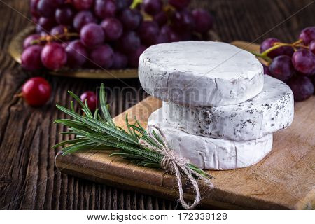 Camembert Cheese With Grape And Branch Of Rosemary