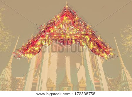 The beautifully decorated pagodas of Wat Pho temple at night. Bangkok, Thailand. Traditional religious architecture of Asia. Modern Painting. Brushed artwork based on photo. Background texture.