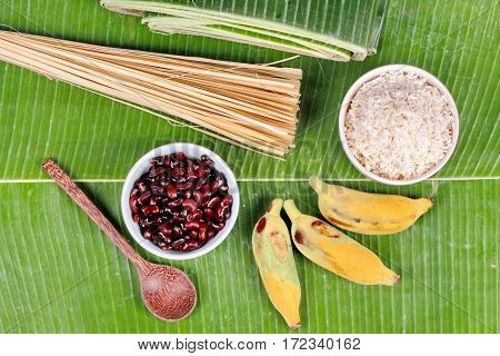 Cooking ,streamed Sticky Rice And Black Bean In Banana Leaf .