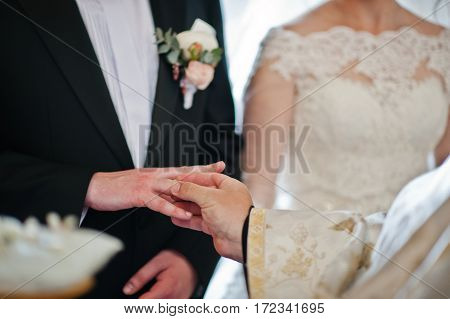 Priest Puts Wedding Ring At Grooms Hand At Church.