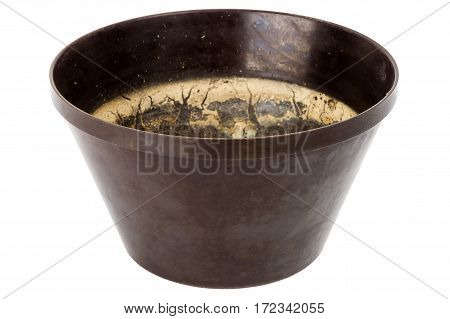 Old grungy plastic flower pot isolated on white background