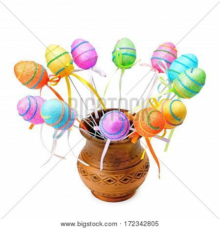Decorative Easter eggs in a clay jug isolated on white background