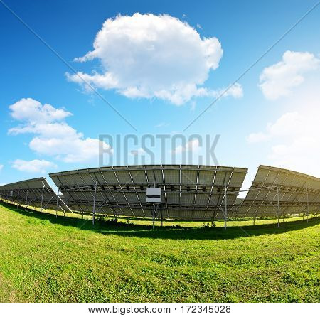 Photovoltaic panels on meadow. Power plant using renewable solar energy.