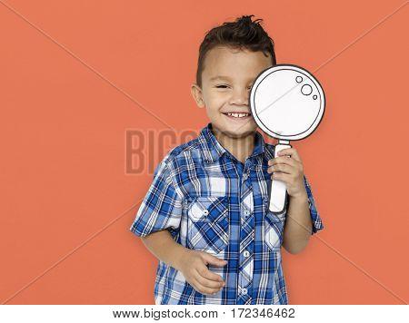 Little boy holding magnifier illustration