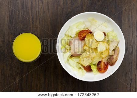 Caesar salad orange juice delicious healthy food tomatoes croutons Parmesan cheese and fresh mozzarella