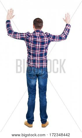 Back view of handsome man in checkered shirt  lwaving from his hands. Standing young guy in jeans. Rear view people collection.  backside view of person.  Isolated over white background.