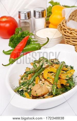 French Bean With Mushrooms Decorated With Parsley And Dill In White Plate On A Background Of Vegetab