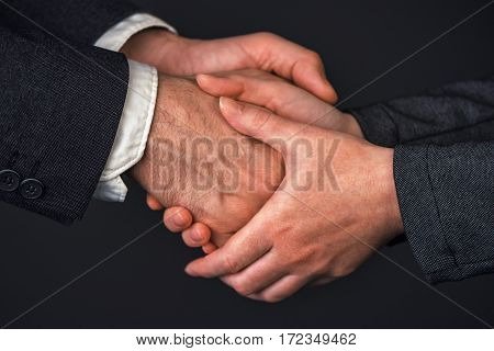 Businessman and businesswoman handshake in office people greeting each other at business meeting close up of hands