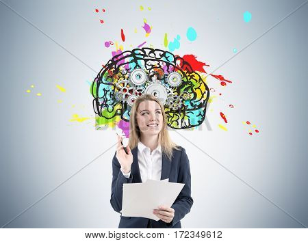 Woman With Documents And Brain With Gears