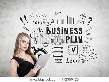 Blond Woman With A Cleavage And Business Plan