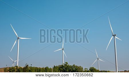 Wind turbine for electricity production on the mountains and beautiful sky.
