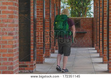 Labuan,Malaysia-April 1,2016:Tourist with backpack at Veteran Memorial Park in Labuan,Malaysia.Labuan island once known as The Pearl of The Orient is one of the World War II allied stronghold and become Jap