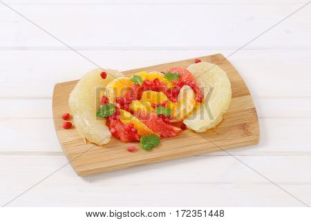 pile of fruit salad on wooden cutting board