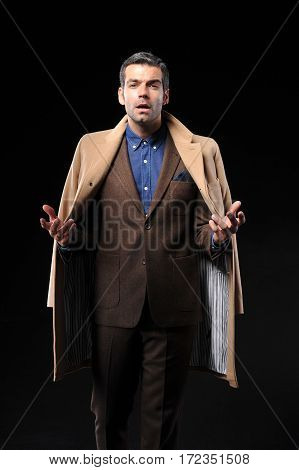young business man wear brown suit and overcoat