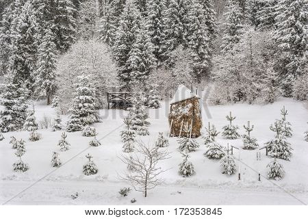 Winter landscape haystack hay the bulk of the hay early snow fabulous landscape winter magic snow white Firs in the snow cold frosty nasty day straw in the Carpathian Mountains Ukraine.