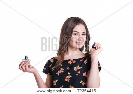 young woman enjoying the smell of the perfume