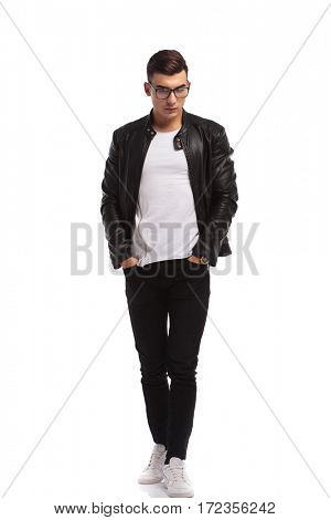 walking young casual man is looking down on white studio background