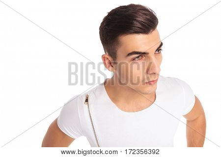 young casual man looking away to a side isolated on white backgorund