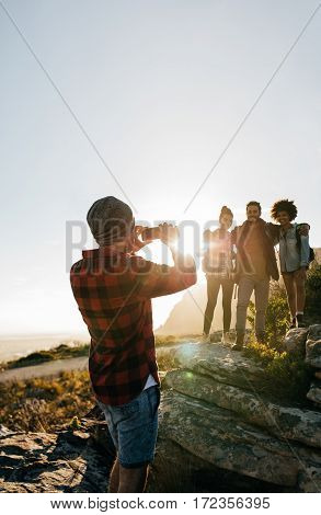 Young Hikers Taking Pictures Outdoors