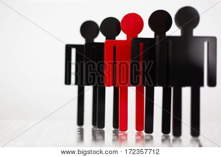 Business concept: thinking outside the box. Human figures of red and black. The image depth of field.