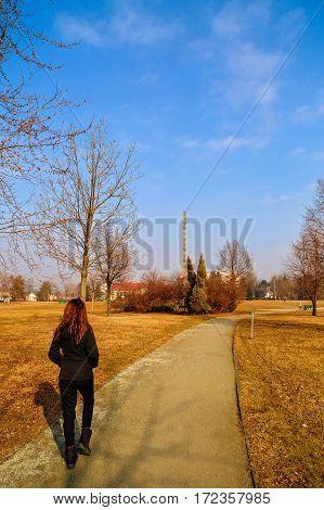 woman tourist traveling through Romania. Targu Jiu endless column