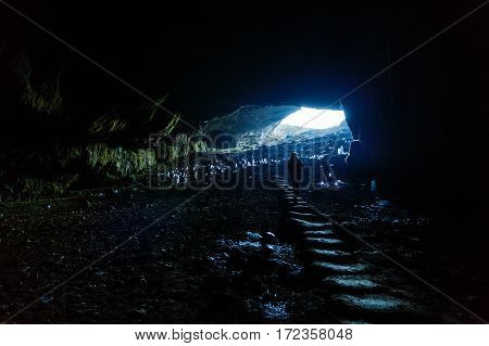 woman tourist traveling through Romania. cave Ponoarele
