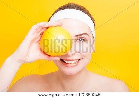 Portrait Of Woman Holding Big Grapefruit