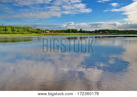 Volga River near the town of Kineshma, Ivanovo region. Reflection of the sky in water. Vastness. Clouds. Volga. Russian landscape