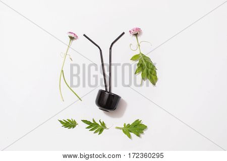Flower patern on a white background. Silhouette of man and woman of flowers. Black mug with a cocktail stick. A family Hawaiian party.