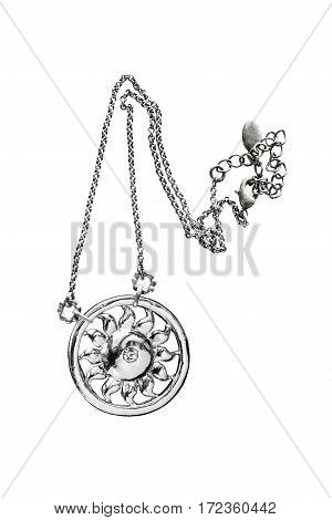 Silver sun shaped pendant on white background
