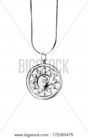Ethnic silver sun shaped medallion on white background