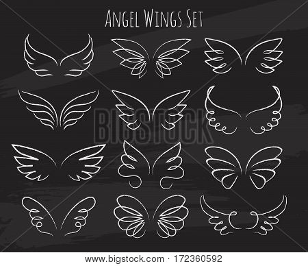 Hand drawn angel wings on chalkboard. Sketch of birds wings. Vector illustration