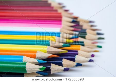 Artistic abstract background row of coloured pencils