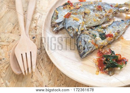Thai style fried mackerel fish with spicy dressing sauce