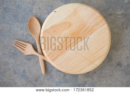 Wood dish wood spoon and wood fork set. Eating concept