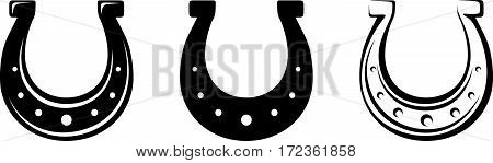Set of three vector black silhouettes of horseshoes isolated on a white background.