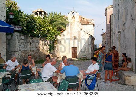 Korcula Croatia - 29 August 2004: People sitting on a bar of Korcula on Croatia