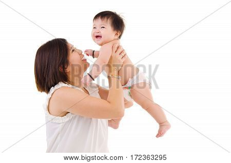 Asian mother lifting up her baby isolated on white background