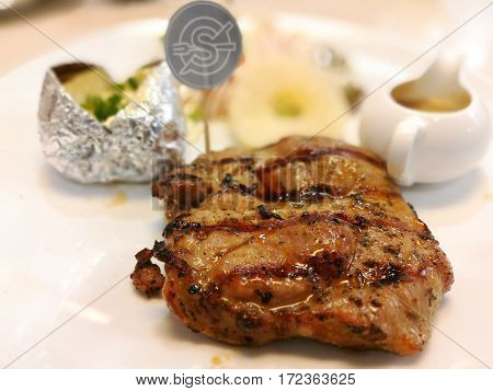 Delicious pork steak with black pepper and spicy