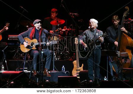 BROOKLYN, NY-DEC 9: James Taylor (L) and Jimmy Buffett perform at WCBS-FM 101.1's Holiday in Brooklyn at Barclays Center on December 9, 2016 in Brooklyn, New York.